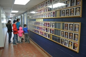 "Booms shows the Smith family the ""Breeder Wall of Fame."""